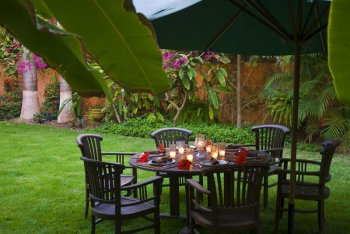 Outdoor Dining Table in the Lush Gardens at Quinta Christileen, a luxury beach front vacation rental in Punta Mita, Mexico